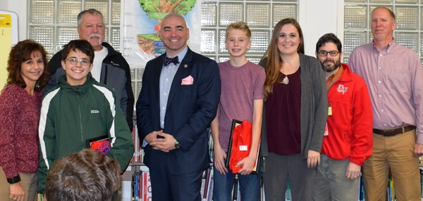 Eighth-grade boys selected for Senator Fred Akshar's All-Stars student recognition program pose with their parents, and the senator, who came into the Vestal Middle School library during their study hall on November 27 to present them with their awards.