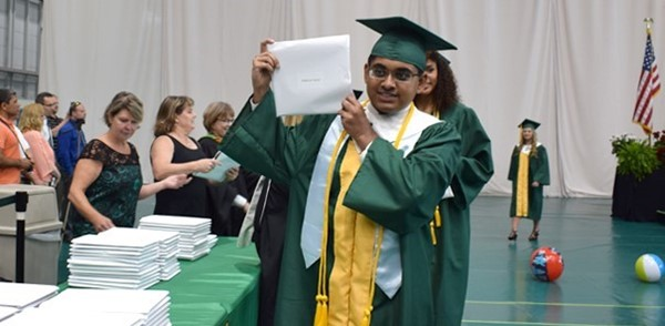 Madhaven Murali proudly brandishes his diploma during Vestal High School's 2017 graduation