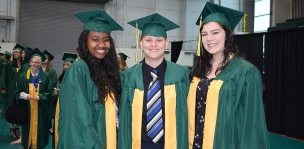 Three Vestal High School members of the Class of 2017 enjoy a quiet moment before the ceremony.