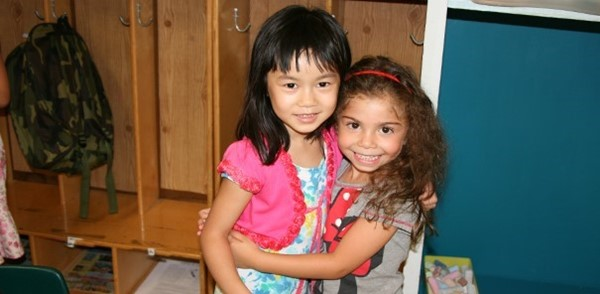 Two friends share a hug during last year's Universal Pre-Kindergarten orientation at the Jewish Community Center