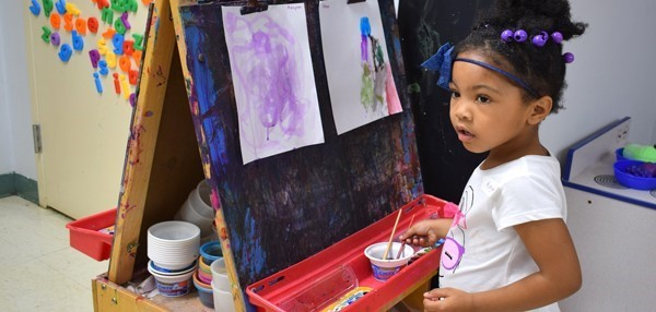 A Universal Pre-Kindergarten student at the Jewish Community Center campus works on her artistic masterpiece at an easel in the classroom during U P K  Orientation in September.