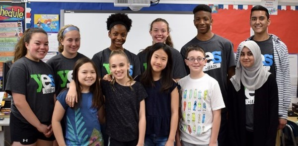 Four fifth-graders who participated in the Safe Choices exercise pose for a photo in their Vestal Hills Elementary School classroom with members of the Vestal High School YES Leads team who presented on May 9, 2018