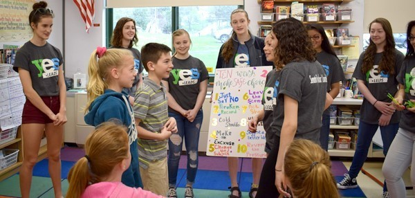 A fifth-grade girl and boy at Tioga Hills Elementary School participate in an exercise demonstrating the 10 Ways to Say No when a peer asks you to engage in risky behavior, during a presentation by Vestal High School YES Leads students on May 10, 2018