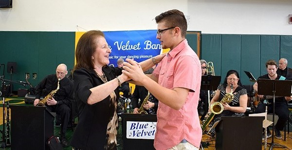 A Vestal High School senior boy dances with a female guest during the Swing into Spring Dance at Vestal High School on May 18, 2018