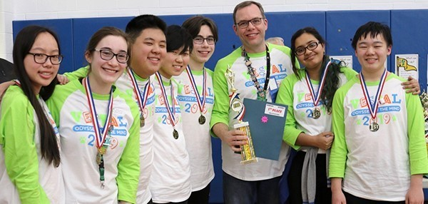 Vestal High School Odyssey of the Mind team (four girls and three boys) with their coach after their regional tournament win on March 9, 2019.