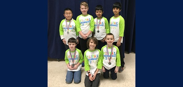 Vestal Hills Elementary's Odyssey of the Mind team (consisting of seven boys) wearing their regional tournament award medals on March 9, 2019.